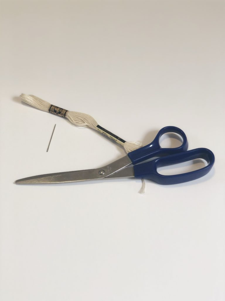 Scissors, embroidery floss, needle.