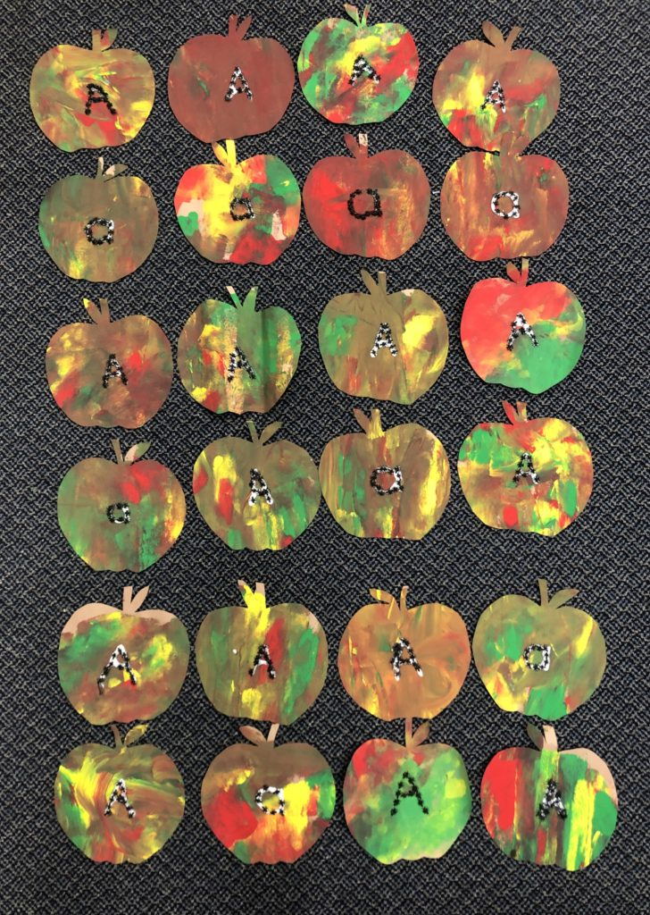 Kindergarten Letter A Craft: Ants on Apples in the shape of a letter A.