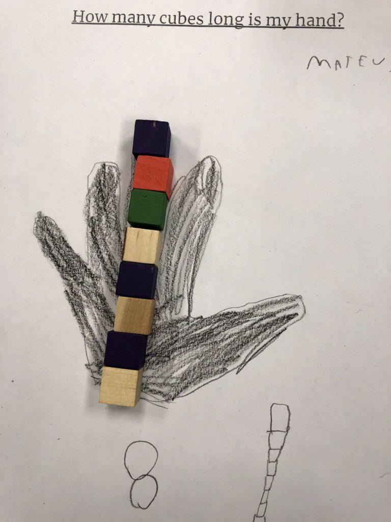 Measuring hands with blocks in Kindergarten